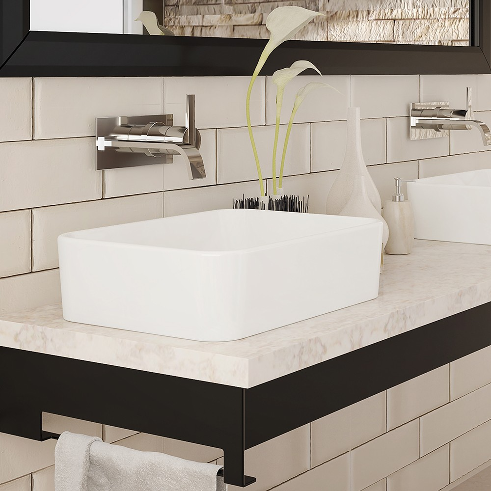 The Gemma above counter rectangular vitreous china sink will be a gem in any bathroom design. Its' high walls and deep basin offer a clean and functional ...